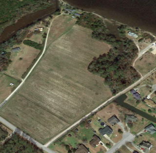 Partner's Forced Bankruptcy Sale: 16.8± Acres Primed for Development with Waterfront Views.